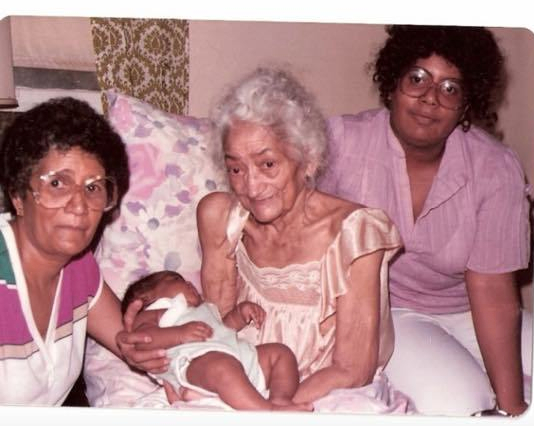 Multi-generation shot of a baby Sabrina and her mother and grandmothers